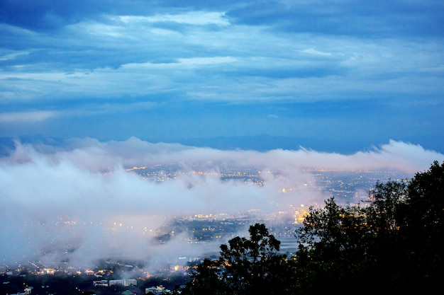 Chiang mai city on landscape doi suthep mountain in twilight sky with misty cloud