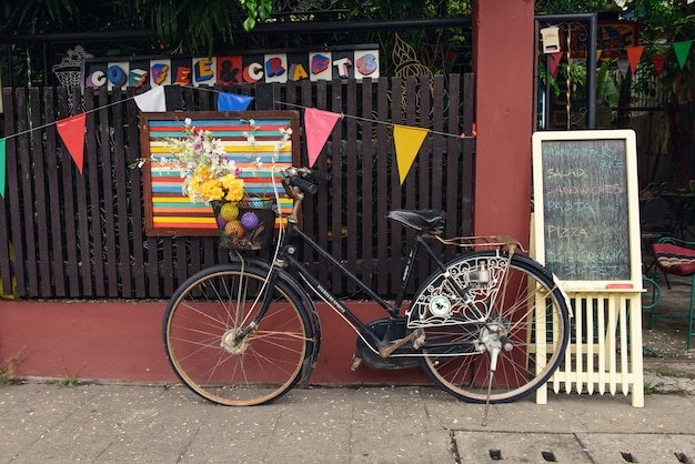 Chiang mai, thailand - june 10, 2016: parking of old bicycle near the cafe in chiang mai city.