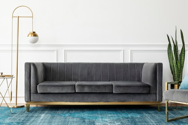 Chic mid-century modern luxury aesthetics living room with gray velvet couch and blue rug