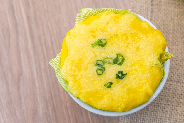 Chica doida, typical brazilian food on a wooden table - corn soup