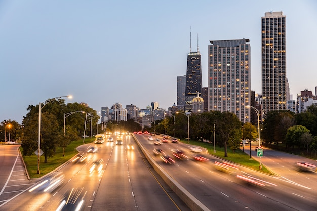 Chicago, traffic on highway with city skyscrapers