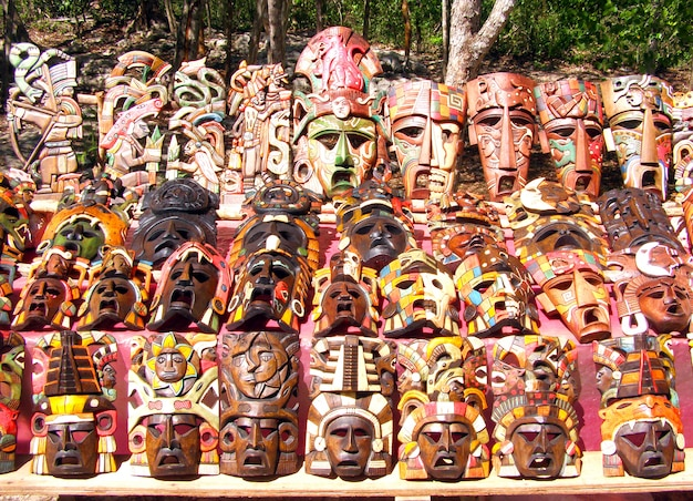 Chichen itza mayan handcrafted wooden masks in yucatan mexico.