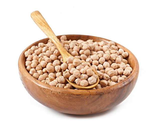 Chick-pea in wooden bowl on wooden surface