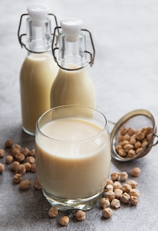 Chick peas milk with chick peas on the table Premium Photo