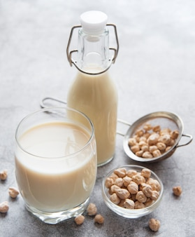 Chick peas milk with chick peas on the table