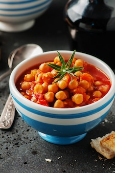 Chick peas with tomato, carrot and rosemary