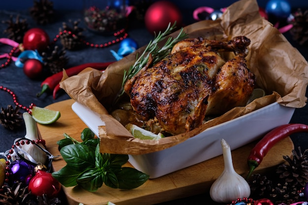 Chicken baked in the oven with spices, lemon and herbs. a dish made for christmas.