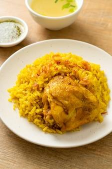Chicken biryani or curried rice and chicken - thai-muslim version of indian biryani, with fragrant yellow rice and chicken - muslim food style