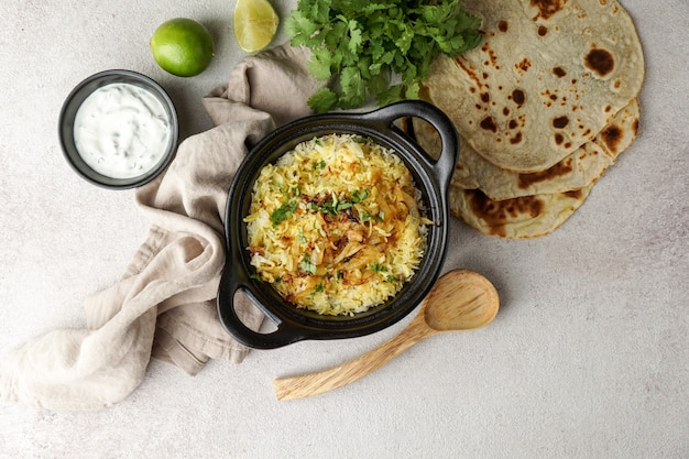 Chicken biryani indian pilaf, with flat bread