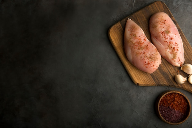 Chicken breast cooking preparation with spices