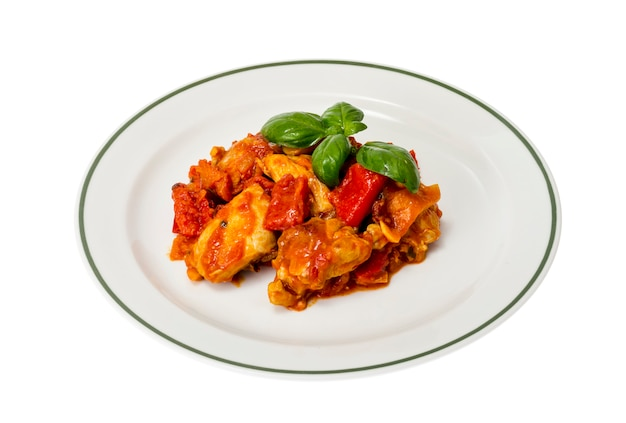 Chicken breast fillet braised with vegetables, paprika.