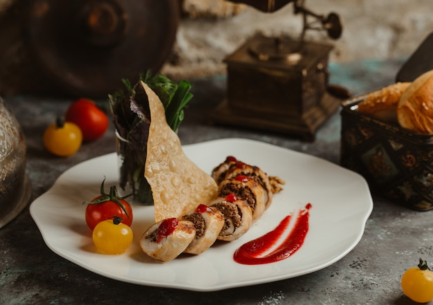 Chicken breast rolls stuffed with meat and herbs