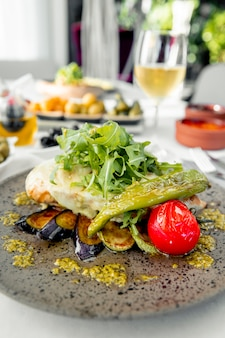 Chicken breast with cheese arugula and grilled vegetables