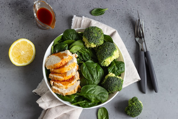 Chicken breast with spinach, broccoli and citrus dressing