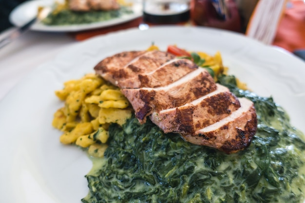 Chicken breast with spinach, potatoes and gnocchi