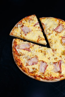Chicken breasts with creamy sauce and grated cheese on a pizza. tasty fresh pizza on a thick crust with meat