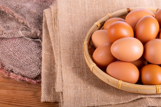 Chicken brown eggs on wicker baskets.healthy eggs food on the rice sack.