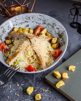 Chicken caesar salad on the table