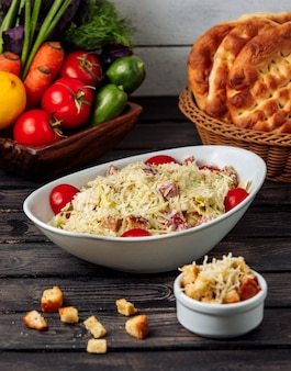 Chicken caesar with grated cheese on the table