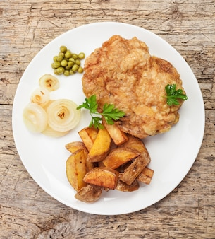 Chicken chop and fries with vegetables