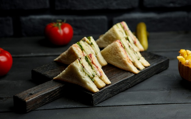 Chicken club sandwich on a wooden board