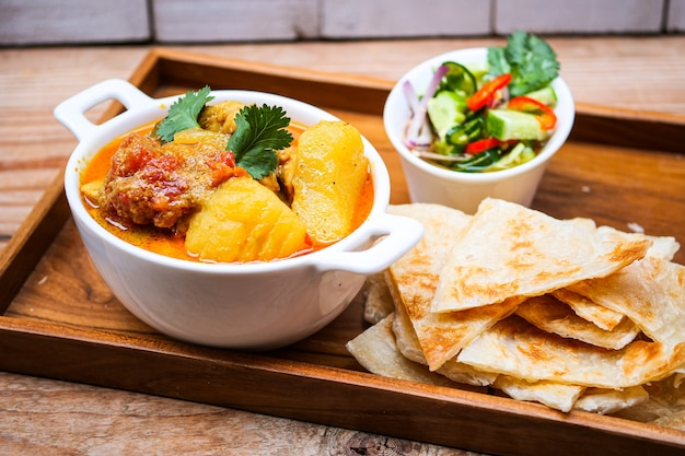 Chicken curry bowl serves with  roti,