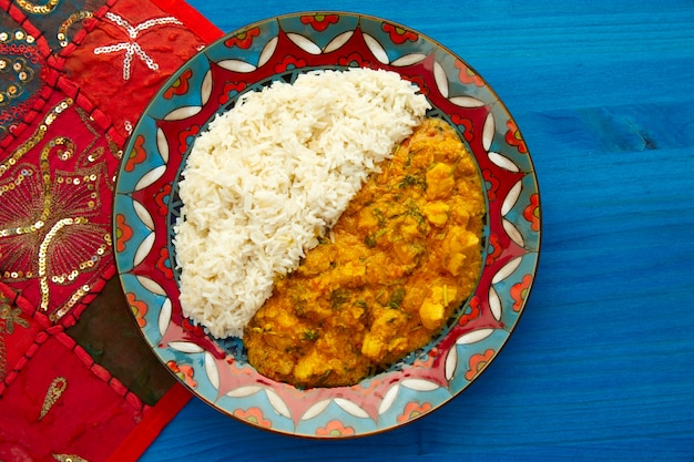 Chicken curry dish indian recipe on blue