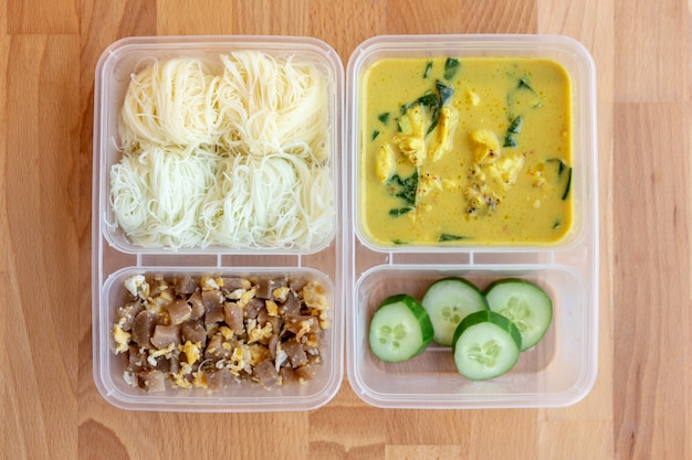 Chicken curry soup with rice vermicelli, fried eggs with preserved turnip and cucumber