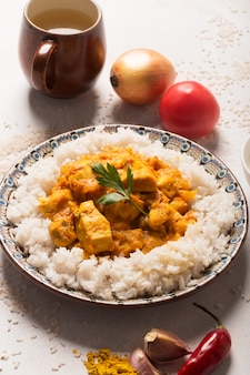 Chicken curry with rice and ingredients