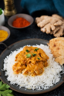 Chicken curry with rice and spices - a traditional popular indian dish