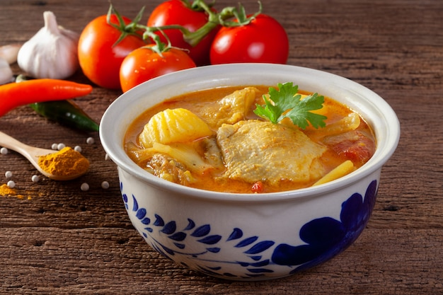 Chicken curry on wooden background