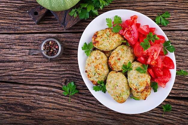 Chicken cutlet with zucchini and tomatoes salad