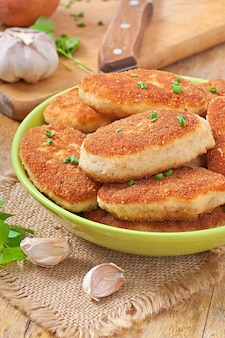 Chicken cutlets in a glass bowl