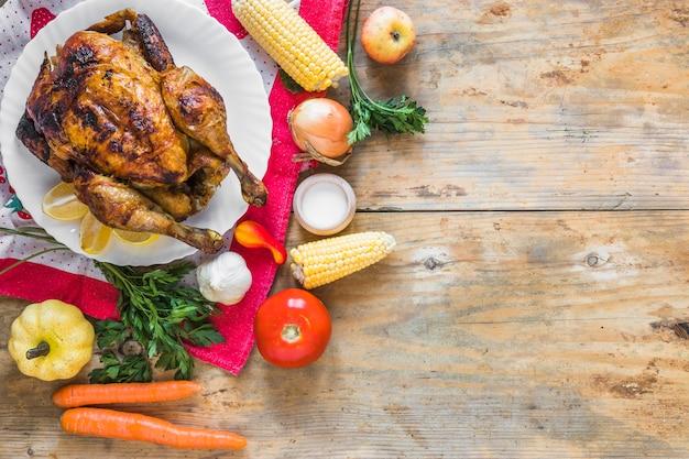 Chicken between different vegetables on tea cloth