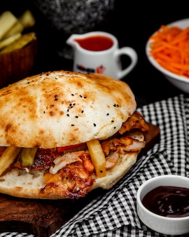 Chicken doner in bread with french fries