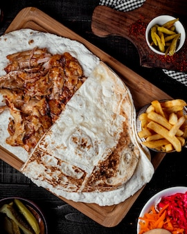 Chicken doner kebab placed on flatbread