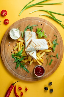 Chicken doner in lavash with fries