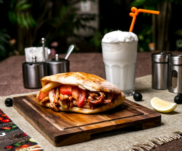 Chicken doner with tomato french fries served with ayran