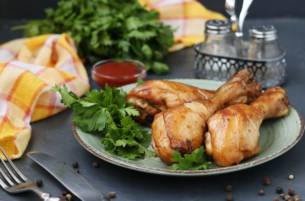 Chicken drumsticks, baked in marinade of ketchup, soy sauce and balsamic vinegar on plate