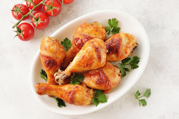 Chicken drumsticks baked in tomato sauce, soy sauce, and olive oil