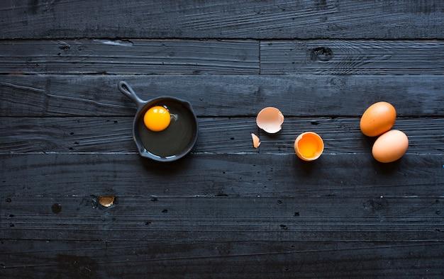 Chicken egg on a dark wooden background