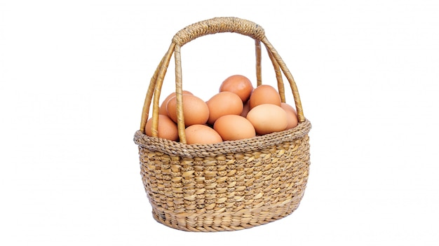 Chicken eggs in a basket on white background.
