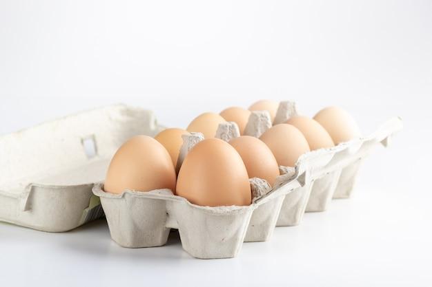 Chicken eggs in a cardboard tray