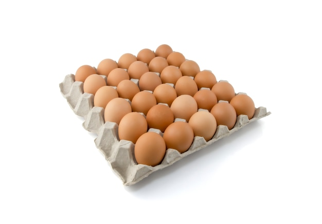 Chicken eggs in carton box isolated on white