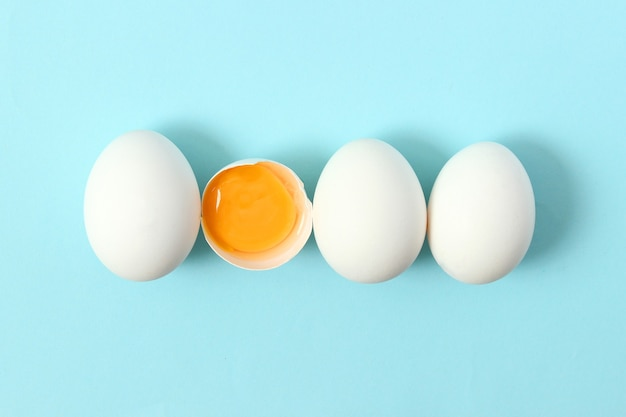 Chicken eggs on a colored background farm products natural eggs