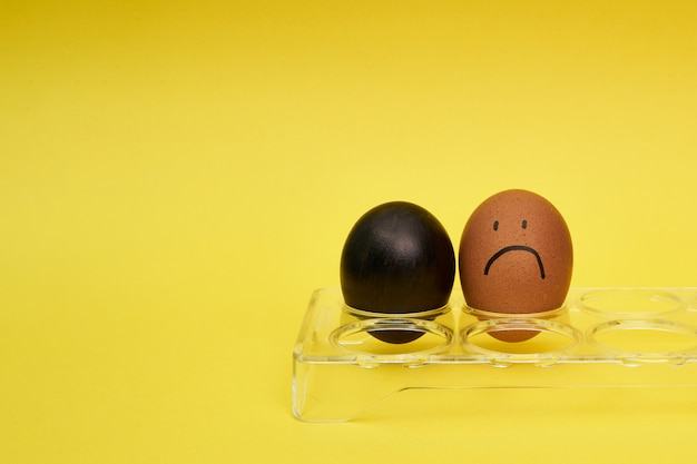 Chicken eggs in an egg holder. emotion and facial expression painted on eggs.