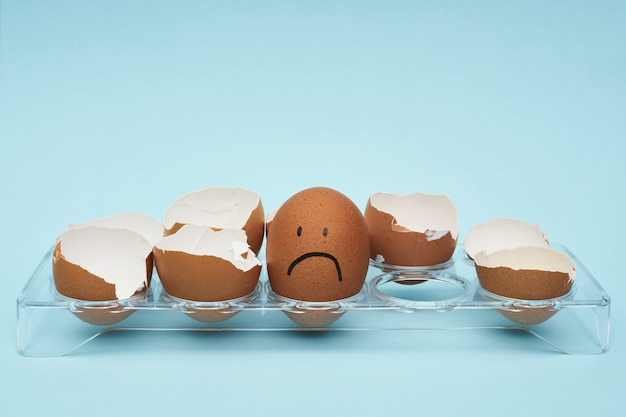 Chicken eggs in an egg holder. full tray of eggs. emotion and facial expression painted on eggs.