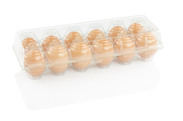 Chicken eggs in a plastic container isolated on a white background