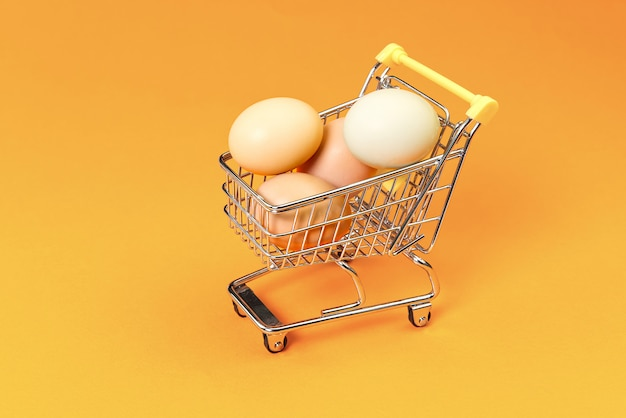 Chicken eggs in a shopping cart.