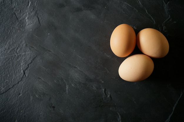 Chicken eggs on slate with text space